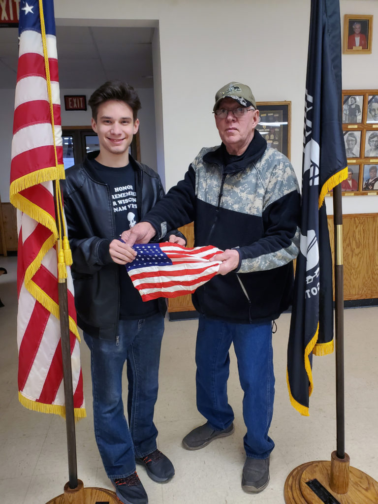 Jordan receiving the flag Mike Duncan had with him on his 4 tours
